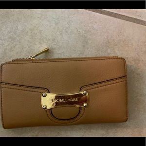 Michael Kors tan wallet.